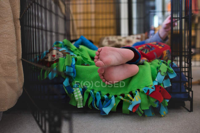 Feet of barefoot little boy in pajamas — Stock Photo