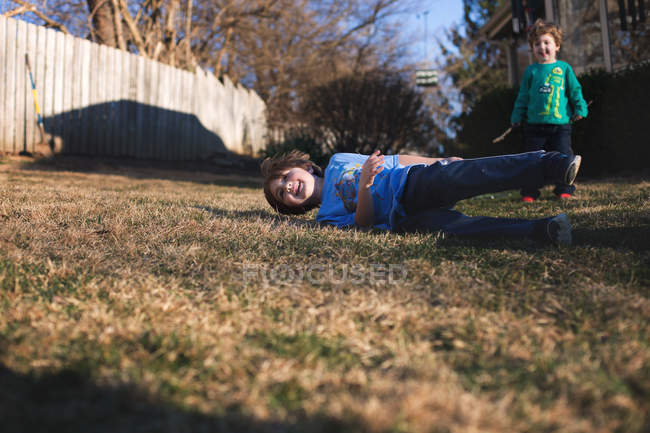 Cute happy brothers playing in backyard — Stock Photo