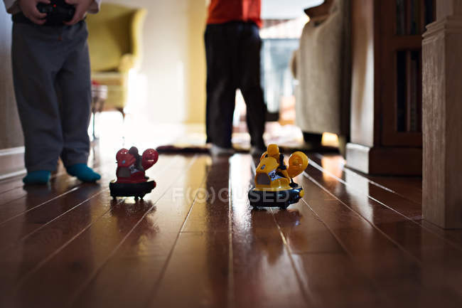 Little boys playing with toys — Stock Photo