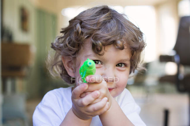 Adorable little boy playing with toy — Stock Photo