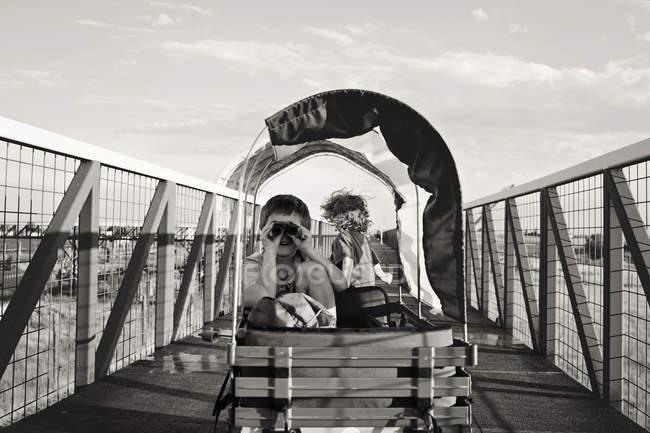 Boys having fun in trolley — Stock Photo