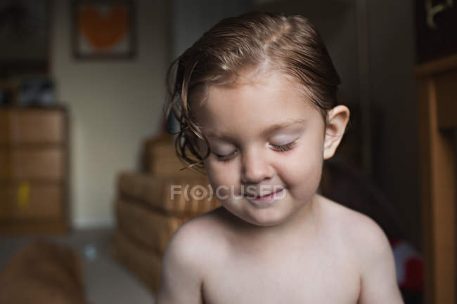 Adorable little boy with wet hair — Stock Photo