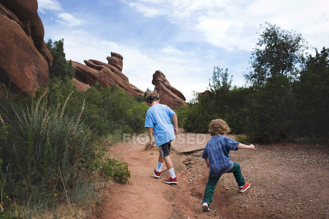 Little boys walking on rural road — Stock Photo