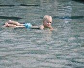 Boy lying in water — Stock Photo