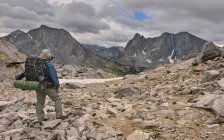 Hiker looking back at Cirque of Towers — Stock Photo