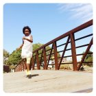 Young girl running on bridge — Stock Photo