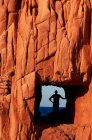 Red rock formation with human silhouette — Stock Photo