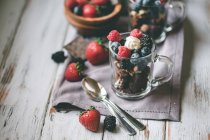 Chocolate with cakes and berries — Stock Photo
