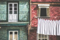 Clothes hanging across street — Stock Photo