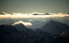 Alpine peaks in golden clouds — Stock Photo