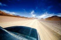Car driving through desert — Stock Photo