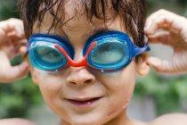 Boy wearing swimming goggles — Stock Photo