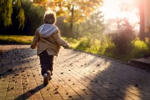 Boy running in park — Stock Photo