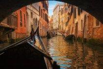 Gondola under bridge — Stock Photo