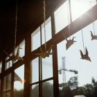 Paper swans on strings — Stock Photo
