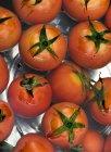 Pile of organic tomatoes — Stock Photo