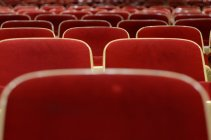Red velvet theater seats — Stock Photo