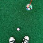 Human legs on golf field — Stock Photo