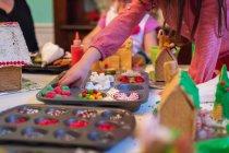 Children decorating houses — Stock Photo