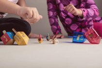 Kids playing with dreidels — Stock Photo
