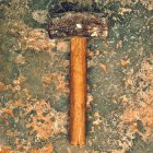 Hammer on weathered surface — Stock Photo