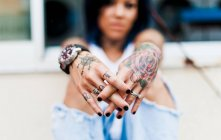 Woman with tattooed hands — Stock Photo