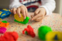 Child playing with toys — Stock Photo