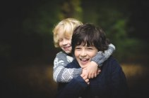 Portrait of two smiling brothers — Stock Photo