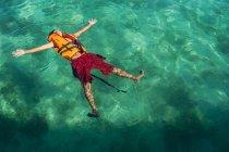 Teenage boy swimming in sea — Stock Photo