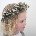 Girl wearing flower headdress — Stock Photo