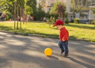 Baby boy playing football — Stock Photo