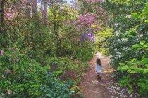 Girl running along path — Stock Photo