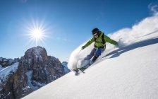 Man skiing off piste — Stock Photo