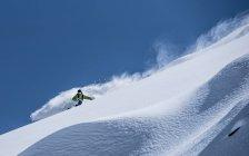 Man powder skiing — Stock Photo