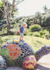 Boy standing on a mosaic turtle — Stock Photo