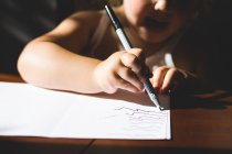 Girl drawing on paper — Stock Photo