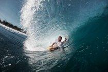 Bodyboarder Riding through tube wave — Stock Photo