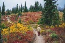 Boy running along  path — Stock Photo