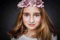 Girl wearing flower head wreath — Stock Photo