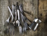 Cutlery on wooden table — Stock Photo