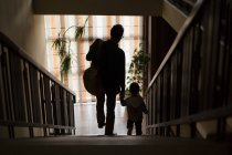 Father and son walking down stairs — Stock Photo