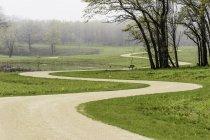 Winding path through park - foto de stock