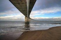 View on sea under bridge — Stock Photo