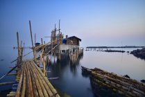 Scenic view of wooden jetty and houses, Ancol, Jakarta, Indonesia — Stock Photo