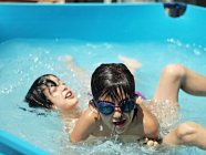 Close-up view of two boys playing in swimming pool — Stock Photo