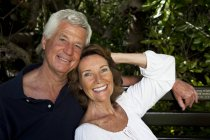 Senior Couple Sitting In Garden On Bench — Stock Photo