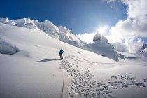 Man walking on glacier in the Swiss Alps, Piz Bernina, Graubunden, Switzerland — Stock Photo