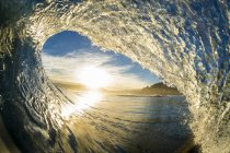 Closeup view of a wave breaking near coast — Stock Photo
