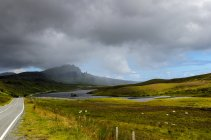 Scenic view of road to Old Man of Storr under dramatic sky, Isle of Skye, Scotland, UK — Stock Photo