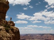 USA, Arizona, Grand Canyon, Hiker standing on edge of cliff and looking at view — Stock Photo